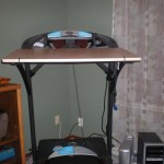 Treadmill desk top bungee corded on